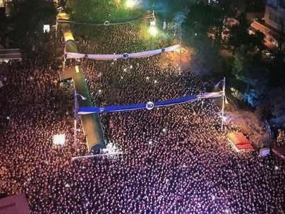 kosovans standing downtown during 10 years celebration