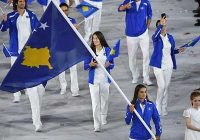 majlinda kelmendi waves flag at olympic ceremony