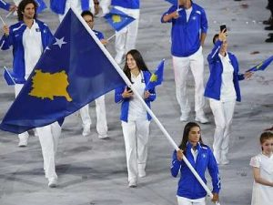 majlinda kelmendi waves flag at olympic ceremony