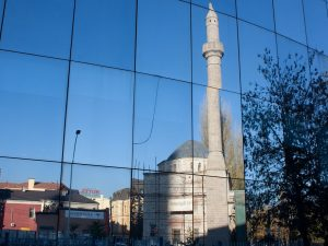 mosque reflects in window