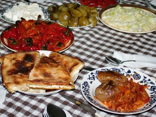 a table full with traditional food of kosovo