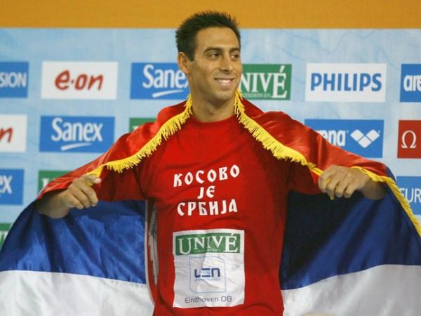 Milorad Cavic wears Kosovo je Srbija shirt