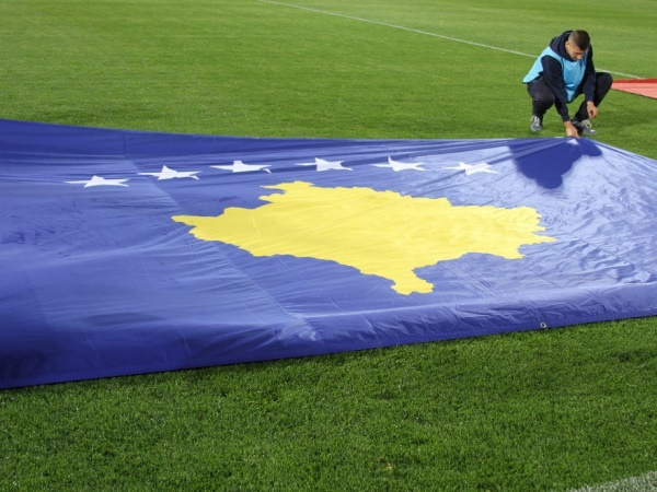 kosovan flag on football pitch