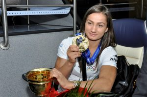 kosovo judo player Majlinda Kelmendi with gold medal